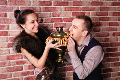 Couple with samovar Royalty Free Stock Photos