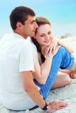Couple on sand. Peaceful couple enjoying summer vacation on sandy shore stock photo