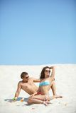 Couple on sand Royalty Free Stock Image