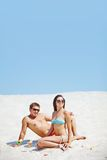 Couple on sand Stock Images