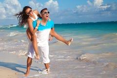 Couple on a sandy tropical beach stock photos
