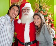 Couple with Santa Claus Royalty Free Stock Photo