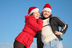 Couple in santa claus hats stock images