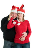 Couple with Santa hats Stock Image