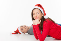 Couple in Santa hats. Stock Photos