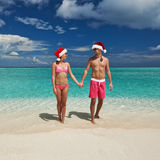 Couple in santa's hat on a beach at Maldives. Couple in santa's hat on a tropical beach at Maldives Stock Photography
