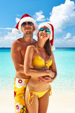 Couple in santa's hat on a beach at Maldives Stock Images