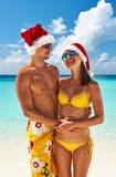 Couple in santa's hat on a beach at Maldives Royalty Free Stock Photos