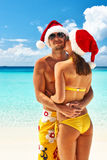 Couple in santa's hat on a beach at Maldives Royalty Free Stock Image