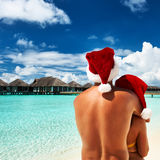 Couple in santa's hat on a beach at Maldives Royalty Free Stock Images