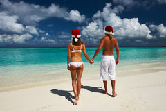 Couple in santa's hat on a beach at Maldives Stock Photo