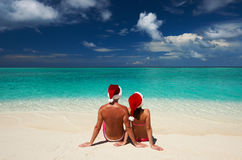 Couple in santa's hat on a beach at Maldives Stock Image