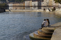 Couple on the Saone river banks in Lyon Stock Photo