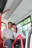 Couple sat on the bus Stock Photos