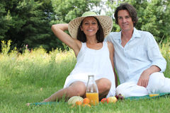 Couple sat in field Stock Image