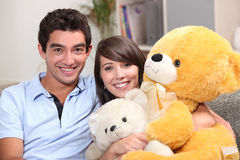 Couple sat with giant teddy Stock Image