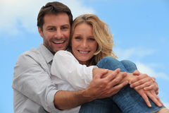 Couple sat hugging each other royalty free stock photo