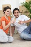 Couple sat in new apartment Stock Image
