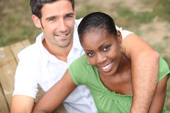 Couple sat on park bench Royalty Free Stock Image