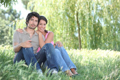 Couple sat in park Royalty Free Stock Photo