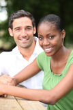 Couple sat at park table Royalty Free Stock Photography