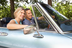Couple sat in sports car Stock Photography