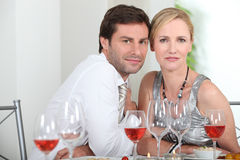 Couple sat at table. With wine glasses Royalty Free Stock Image