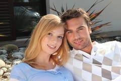 Couple sat on a terrace Stock Photos