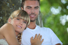 Couple sat by a tree Royalty Free Stock Photography