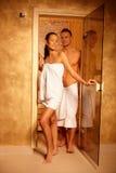 Couple at sauna door. Happy couple standing at sauna door on healthy wellness program Stock Photos