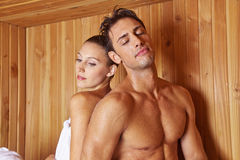 Couple in sauna leaning on each Stock Image