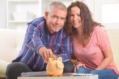 Couple saving money stock photos