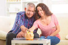 Couple saving money Royalty Free Stock Photography
