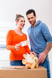Couple saving money by moving house Stock Photos