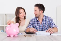 Couple saving money Stock Image