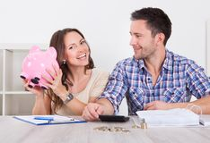 Couple saving money Royalty Free Stock Photos