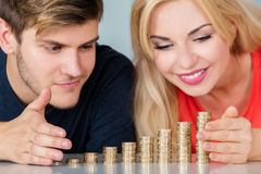 Couple Saving Pile Of Coins royalty free stock photo