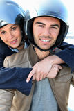 Couple on a scooter Stock Images
