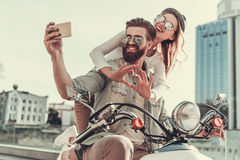 Couple on scooter Royalty Free Stock Image