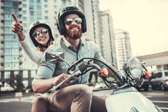 Couple on scooter Royalty Free Stock Images