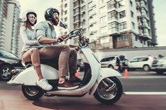 Couple on scooter Stock Photos