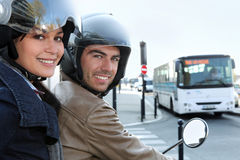 Couple on scooter in a crossroad Royalty Free Stock Photo