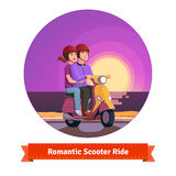 Couple on scooter having a romantic ride Stock Image