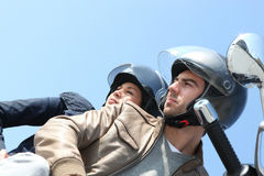 Couple on a scooter outdoors Stock Photography