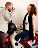 Couple on scooter photographing Royalty Free Stock Images