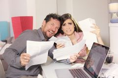 Couple screaming scared about taxes and bills Stock Photography