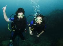 Couple scuba diving on surface Royalty Free Stock Photography