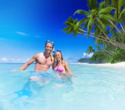 Couple with Scuba Gear in Paradise Royalty Free Stock Images