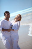 Couple by the sea Stock Photography