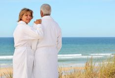 Couple by the sea. In mathcing bath robes Royalty Free Stock Image